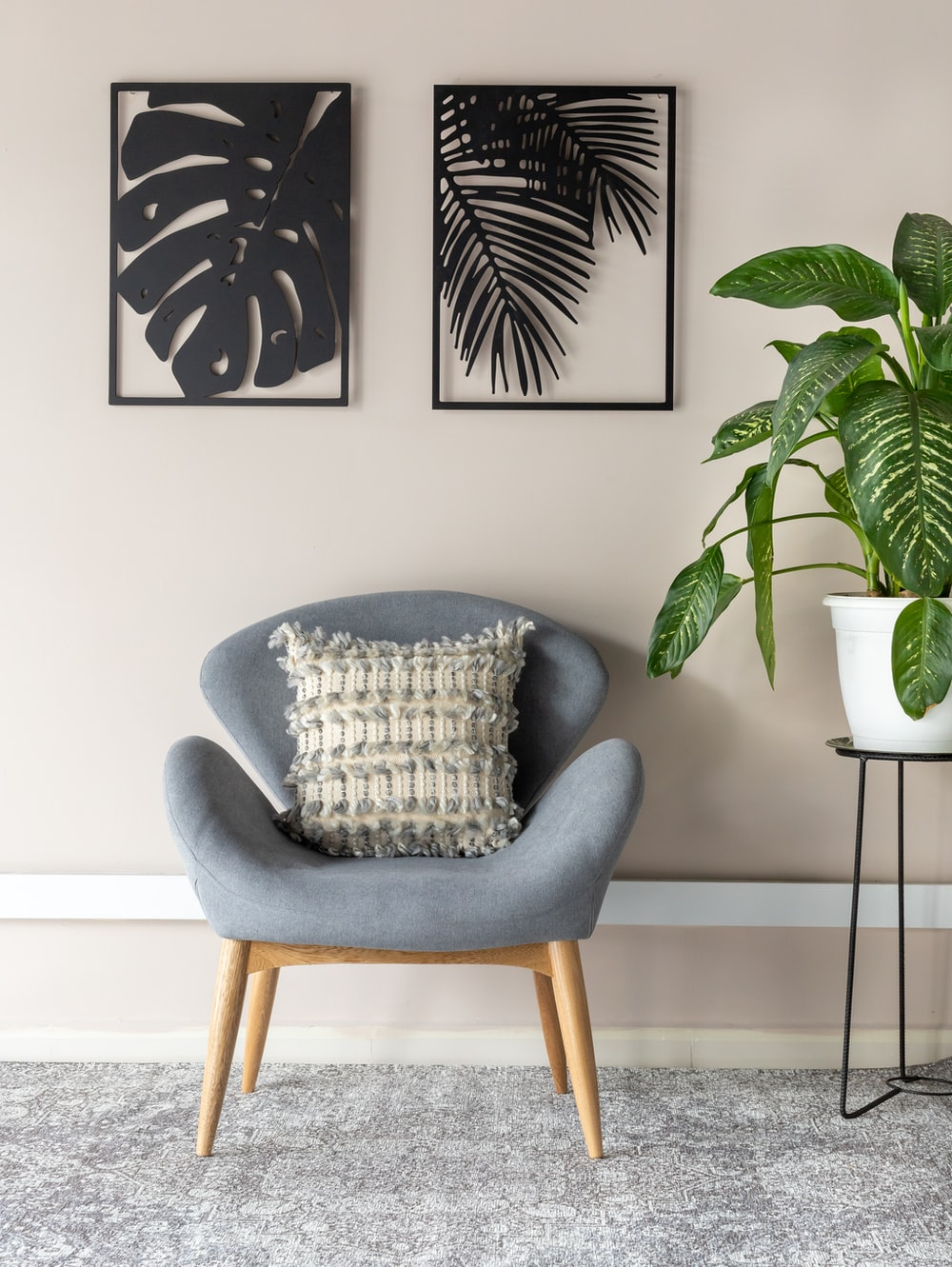 gray and white throw pillow on gray armchair
