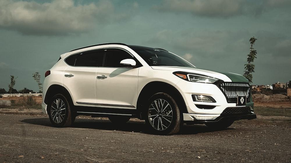 white honda car on gray asphalt road
