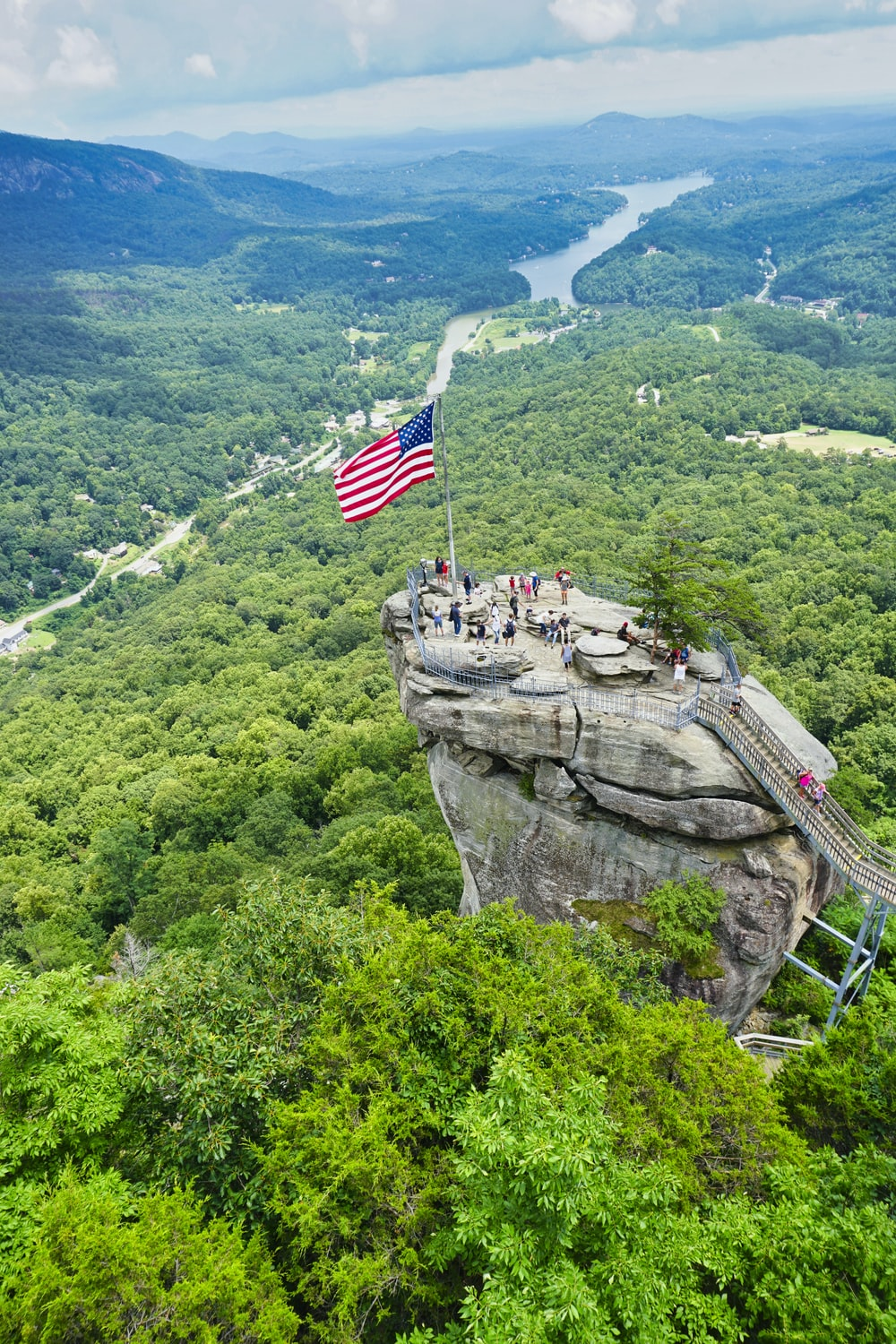 us a flag on top of rock formation