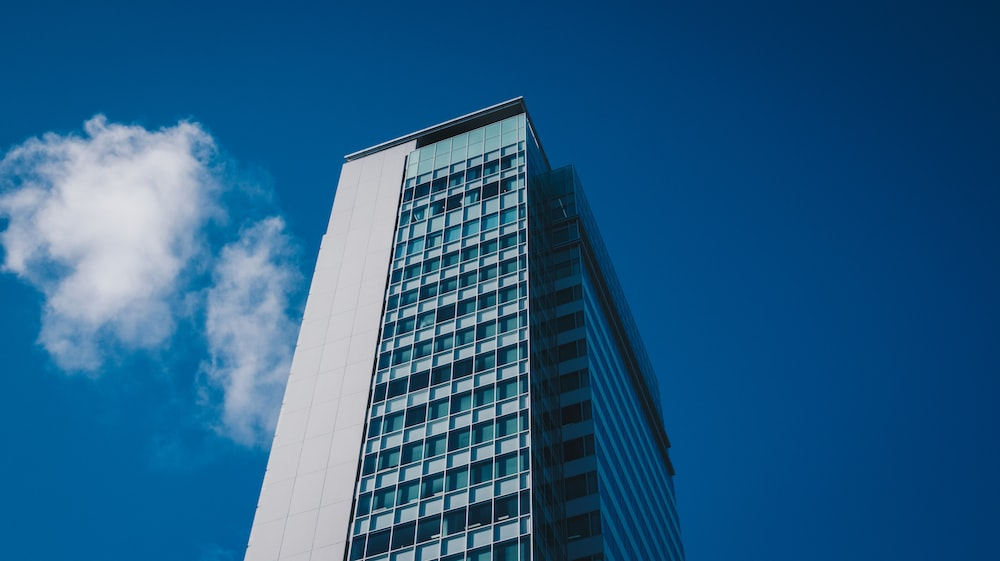 white and black concrete building under blue sky during daytime