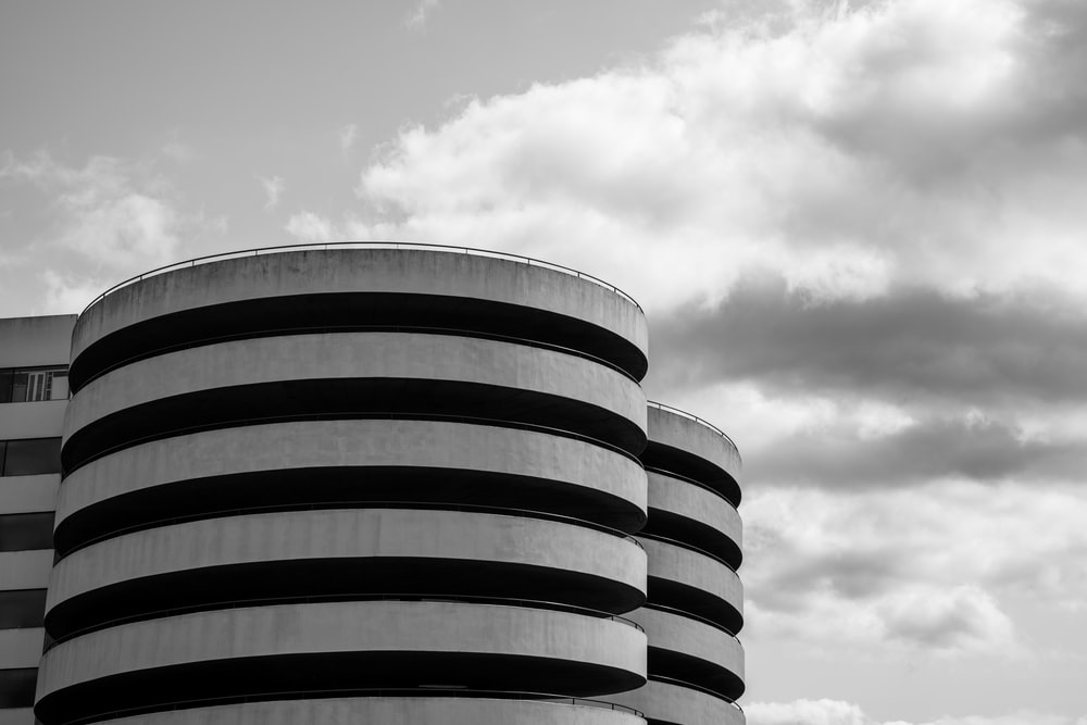 grayscale photo of round building