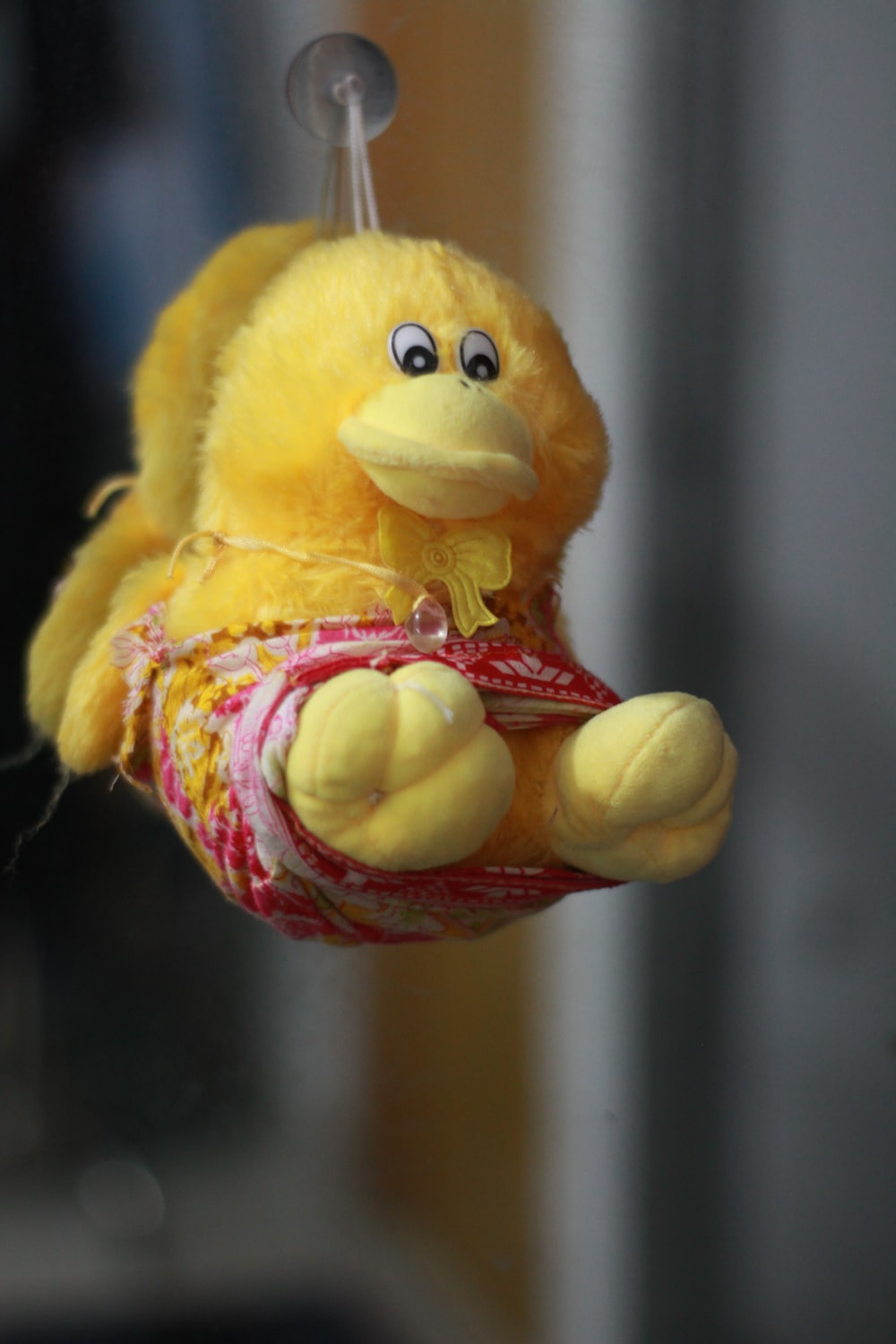 yellow and red duck plush toy