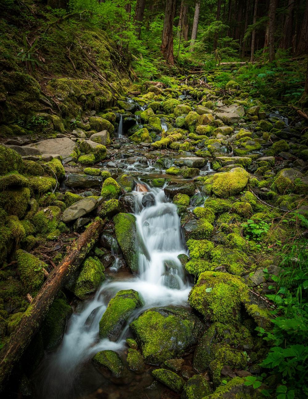 water falls on brown rocks