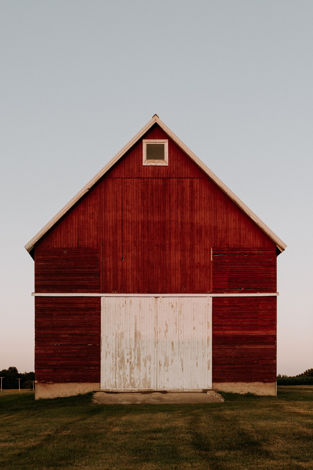 red and white wooden barn house