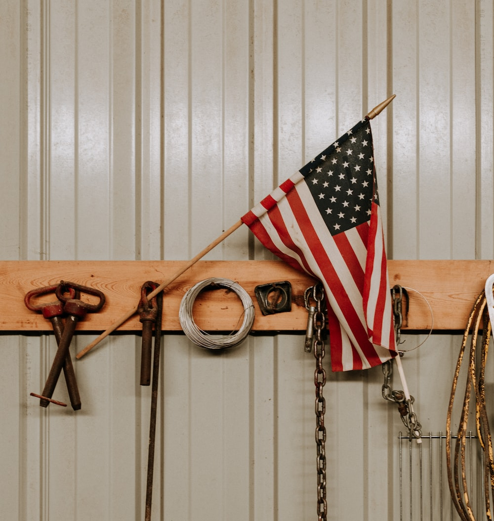 us a flag on brown wooden wall mounted rack