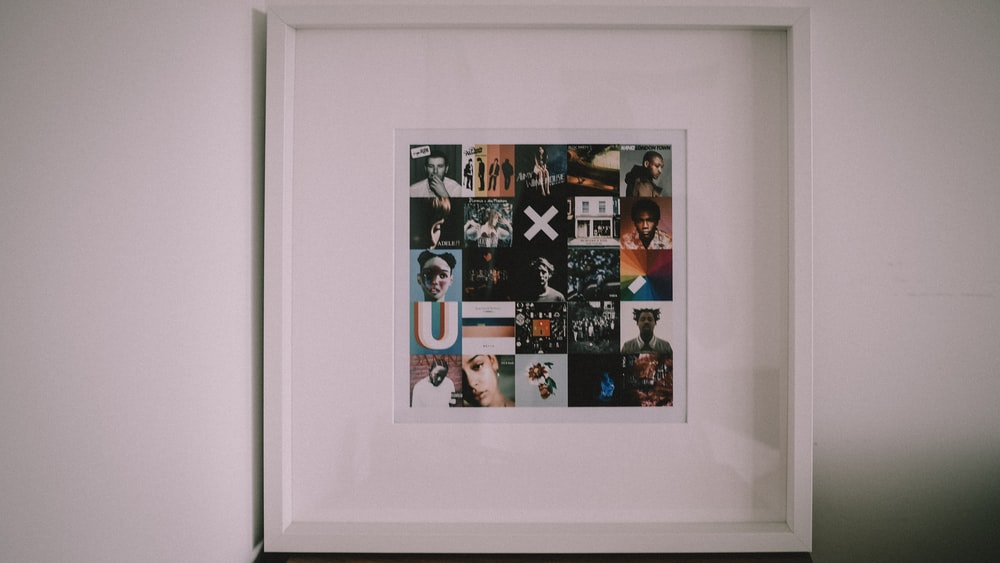 white wooden framed photo of people