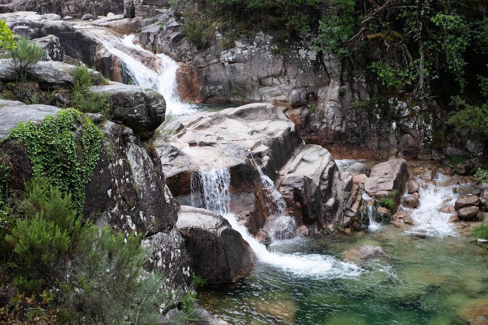 water falls on rocky mountain