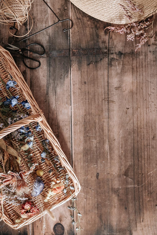 brown woven basket on brown wooden floor