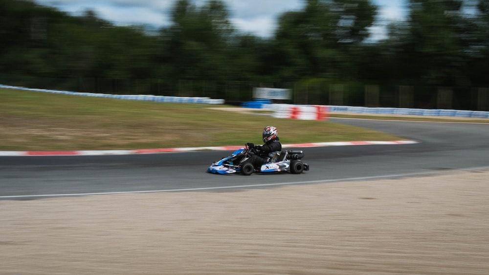 black and blue go kart on track during daytime