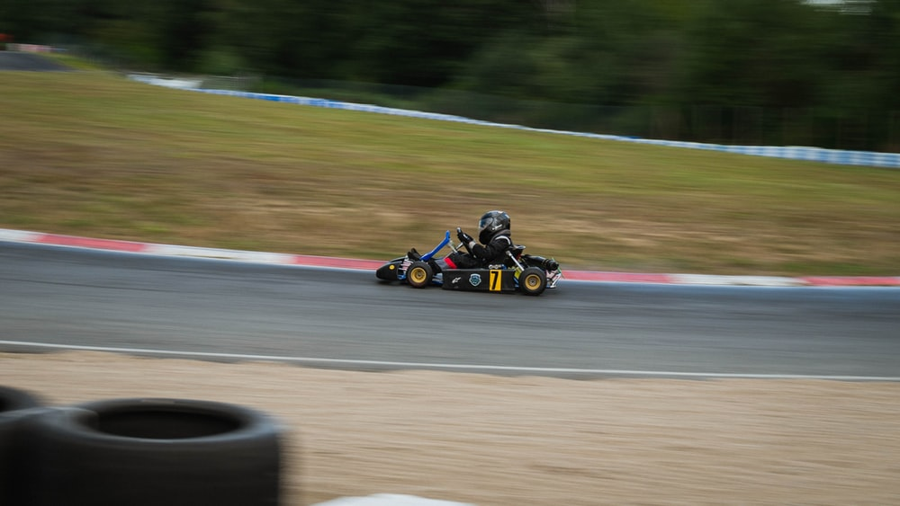 yellow and black go kart on track