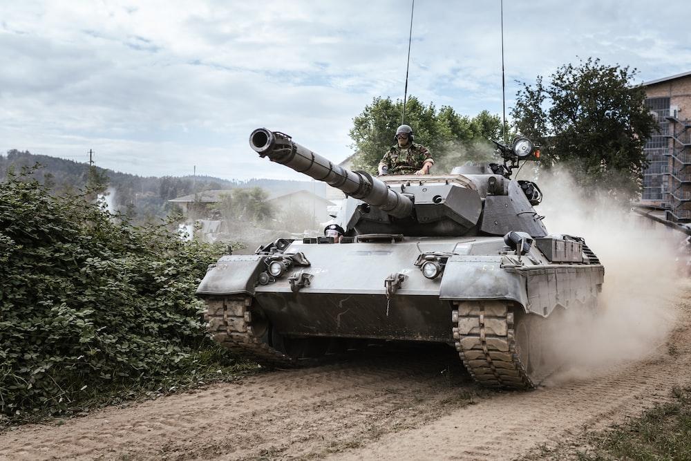 battle tank on green grass field during daytime