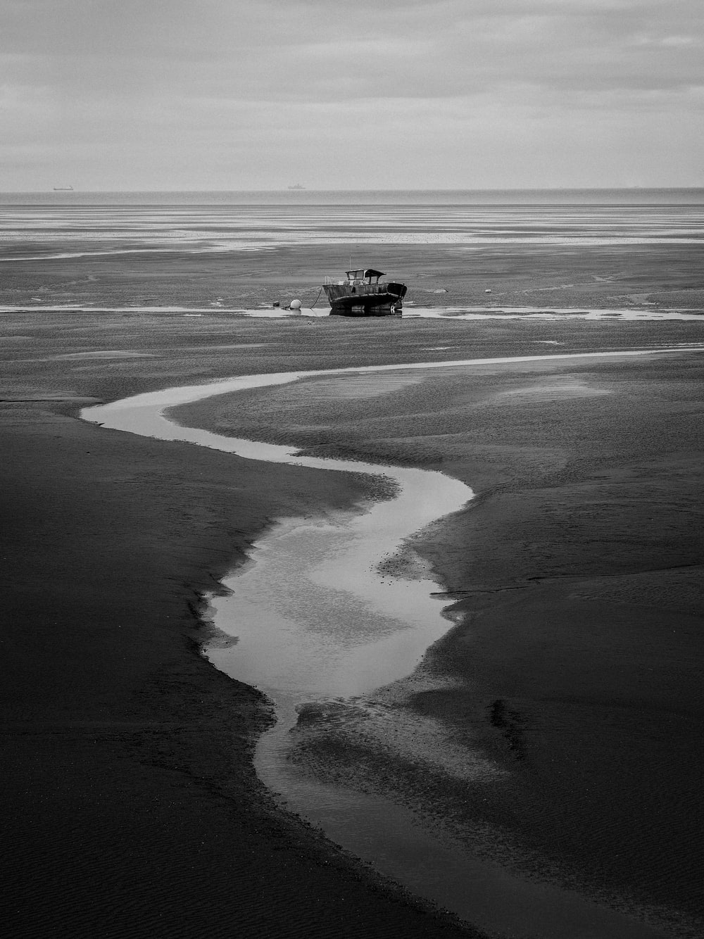 black and white boat on body of water during daytime