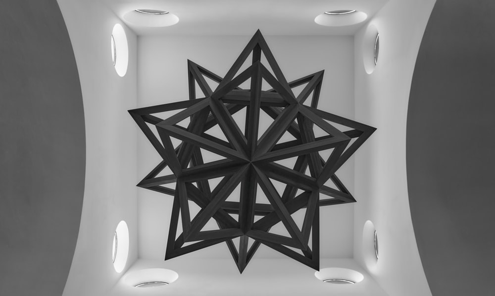 black and white wooden star wall decor