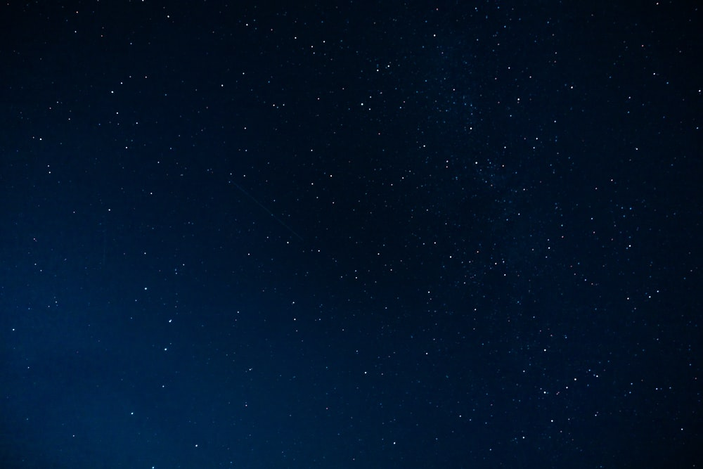 blue sky with stars during night time