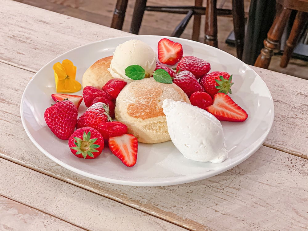 strawberry and strawberry on white ceramic plate