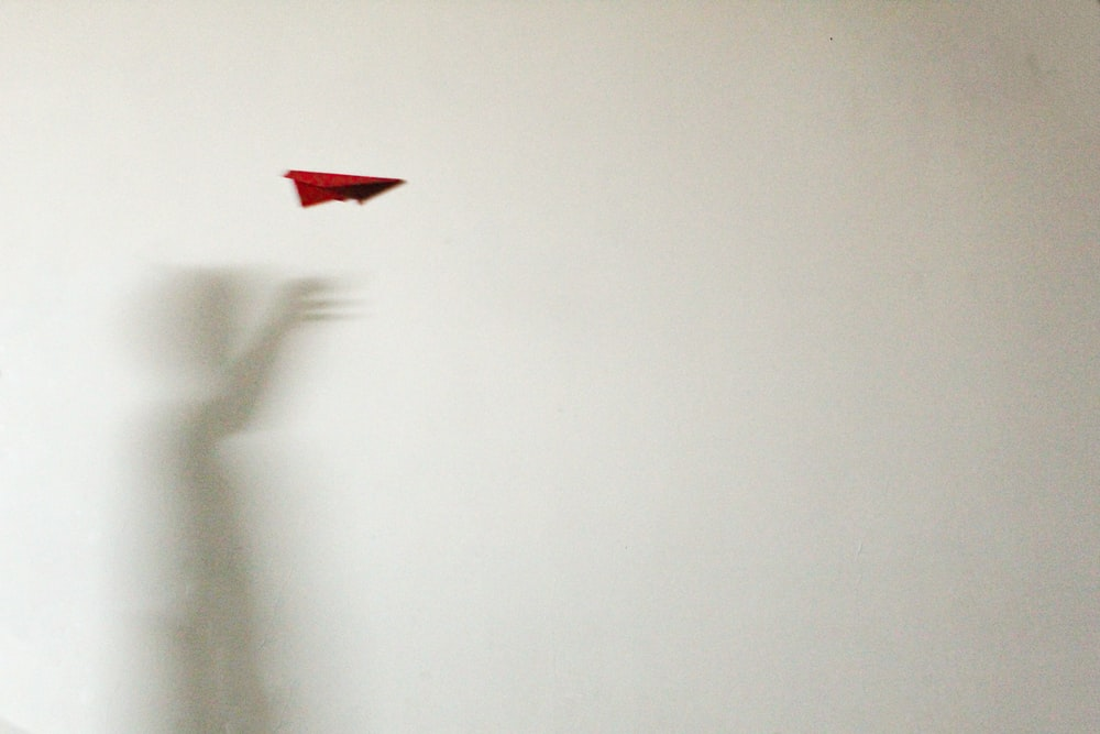 red balloon on white wall