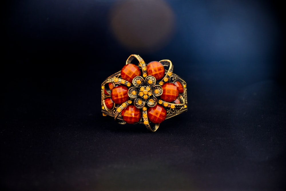 gold and red gemstone ring