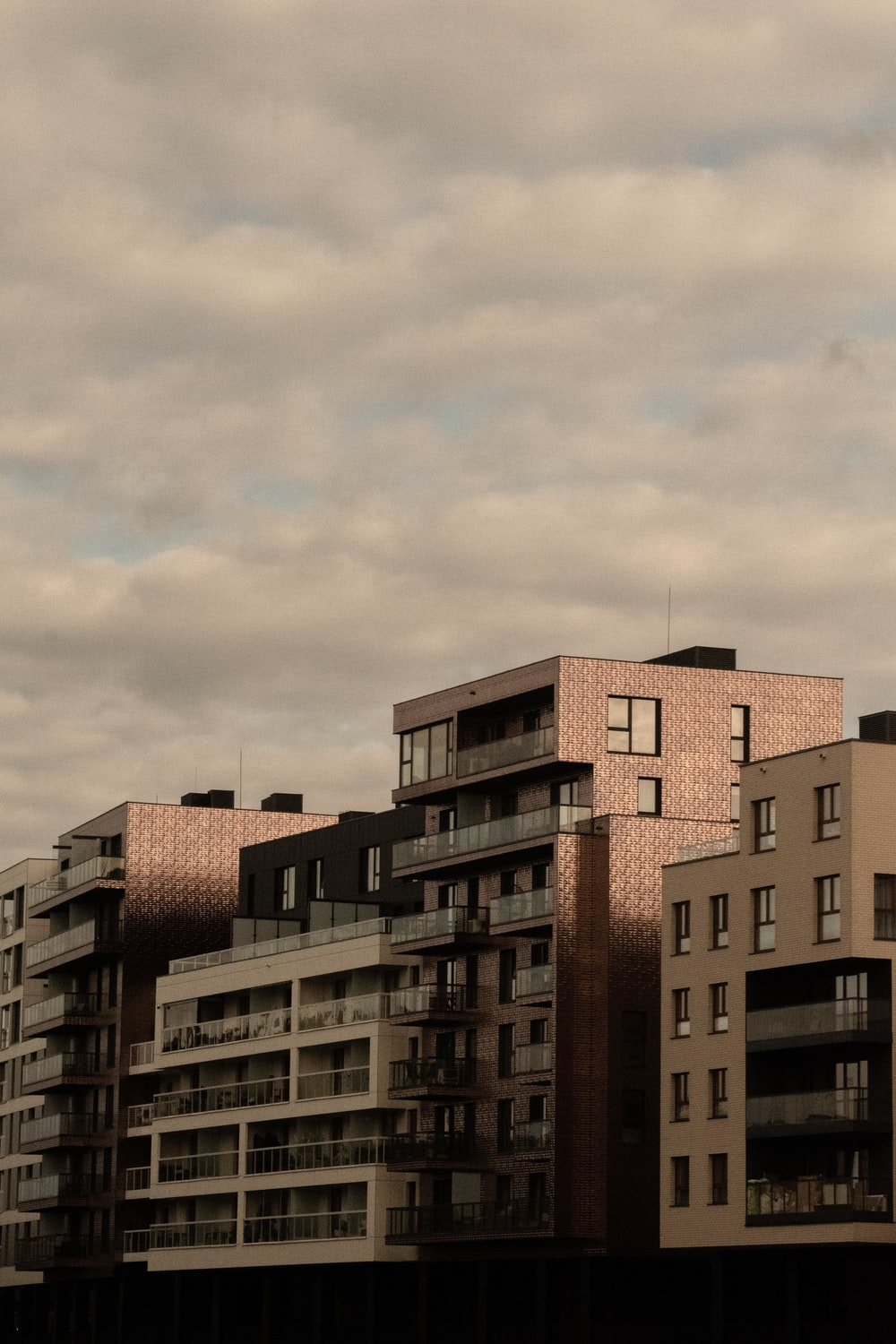 brown concrete building under cloudy sky during daytime