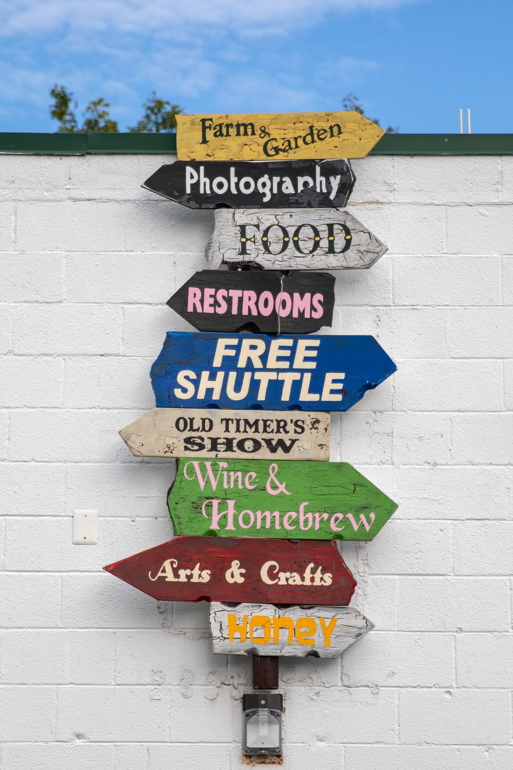 blue and green wooden wall mounted signage