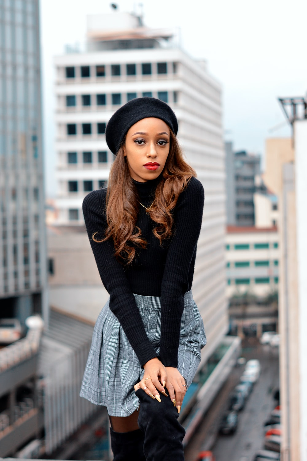 woman in black long sleeve shirt and gray skirt