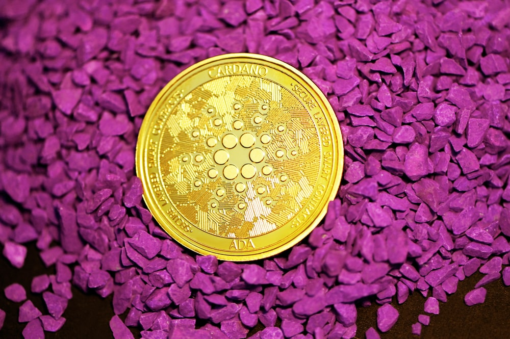 gold round coin on red textile