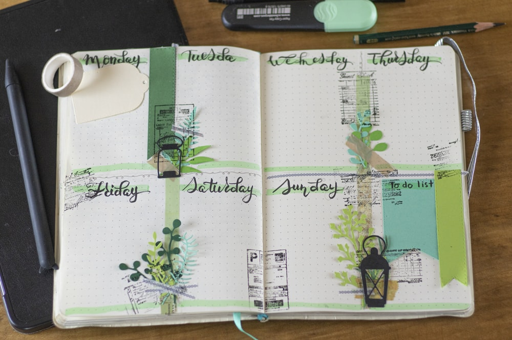 green and black floral on white book page
