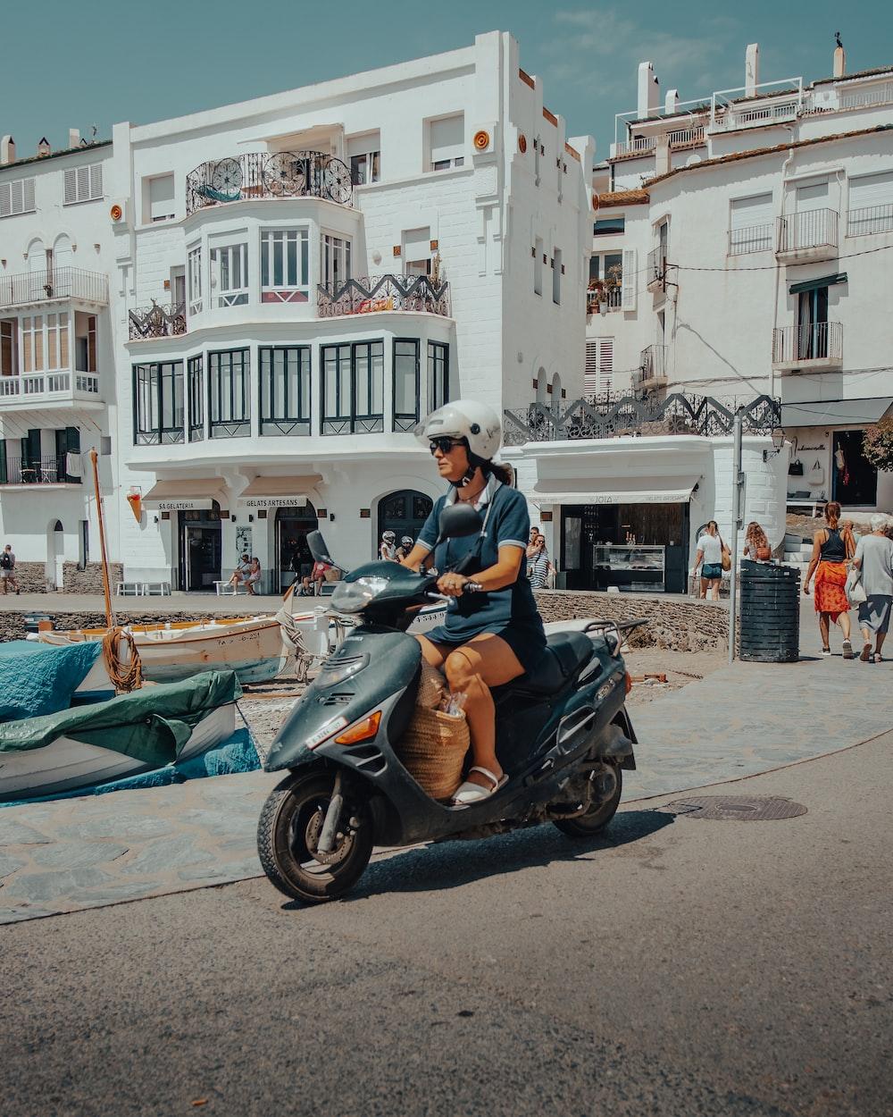 man in black jacket riding on black motor scooter