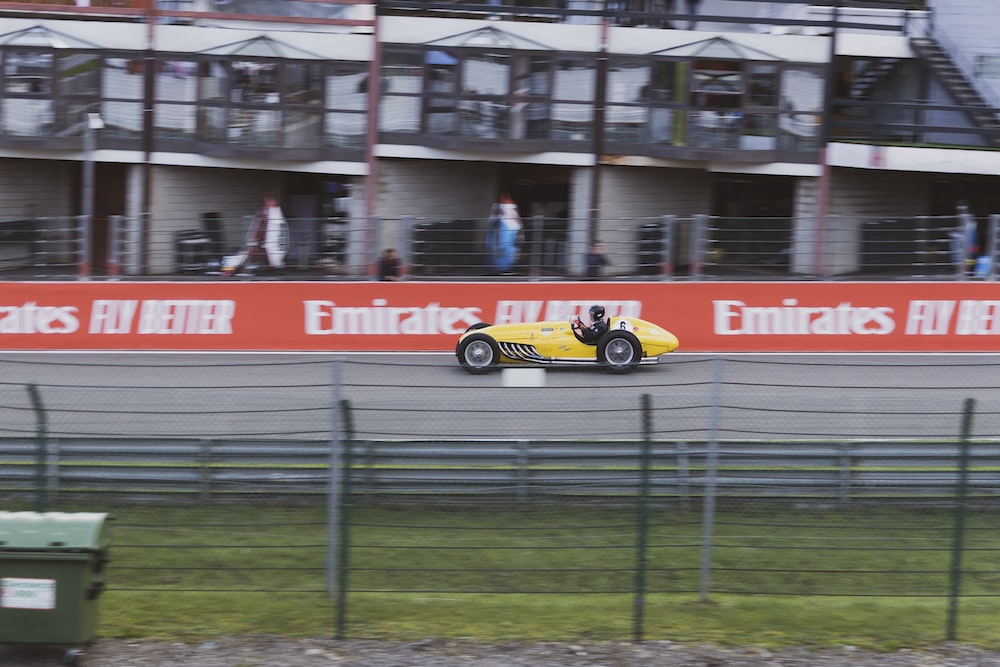 yellow and black racing car on road during daytime