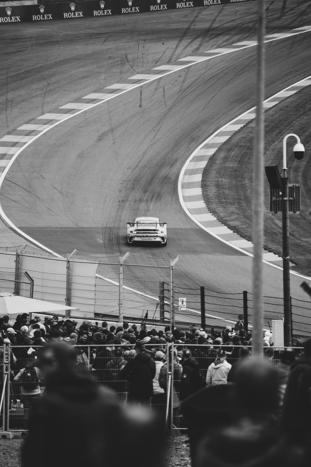 grayscale photo of people on race track