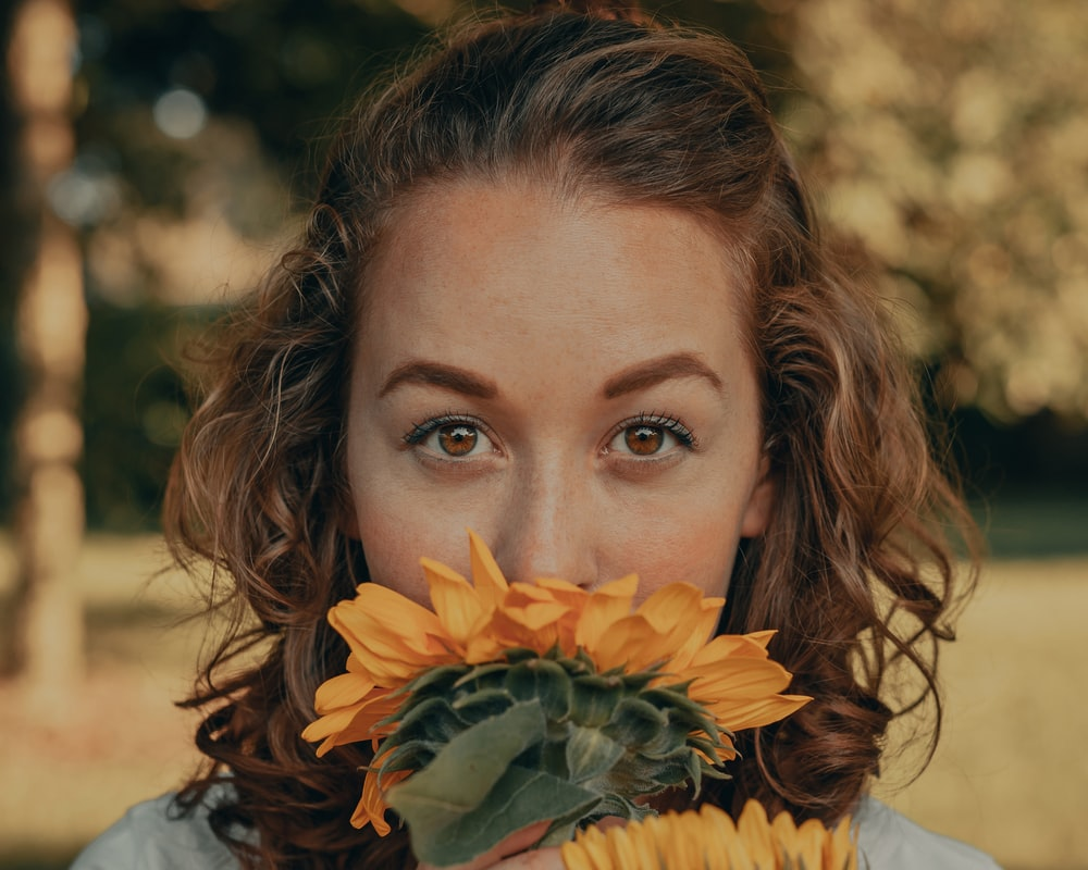 woman with yellow sunflower on her head