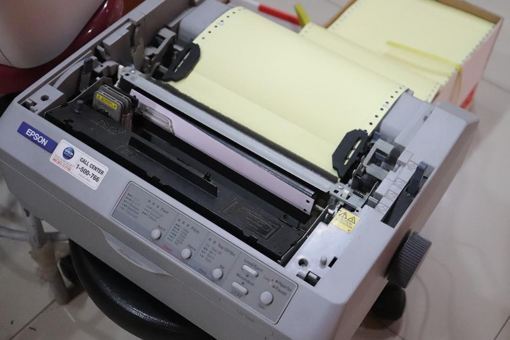 white and gray printer on white table