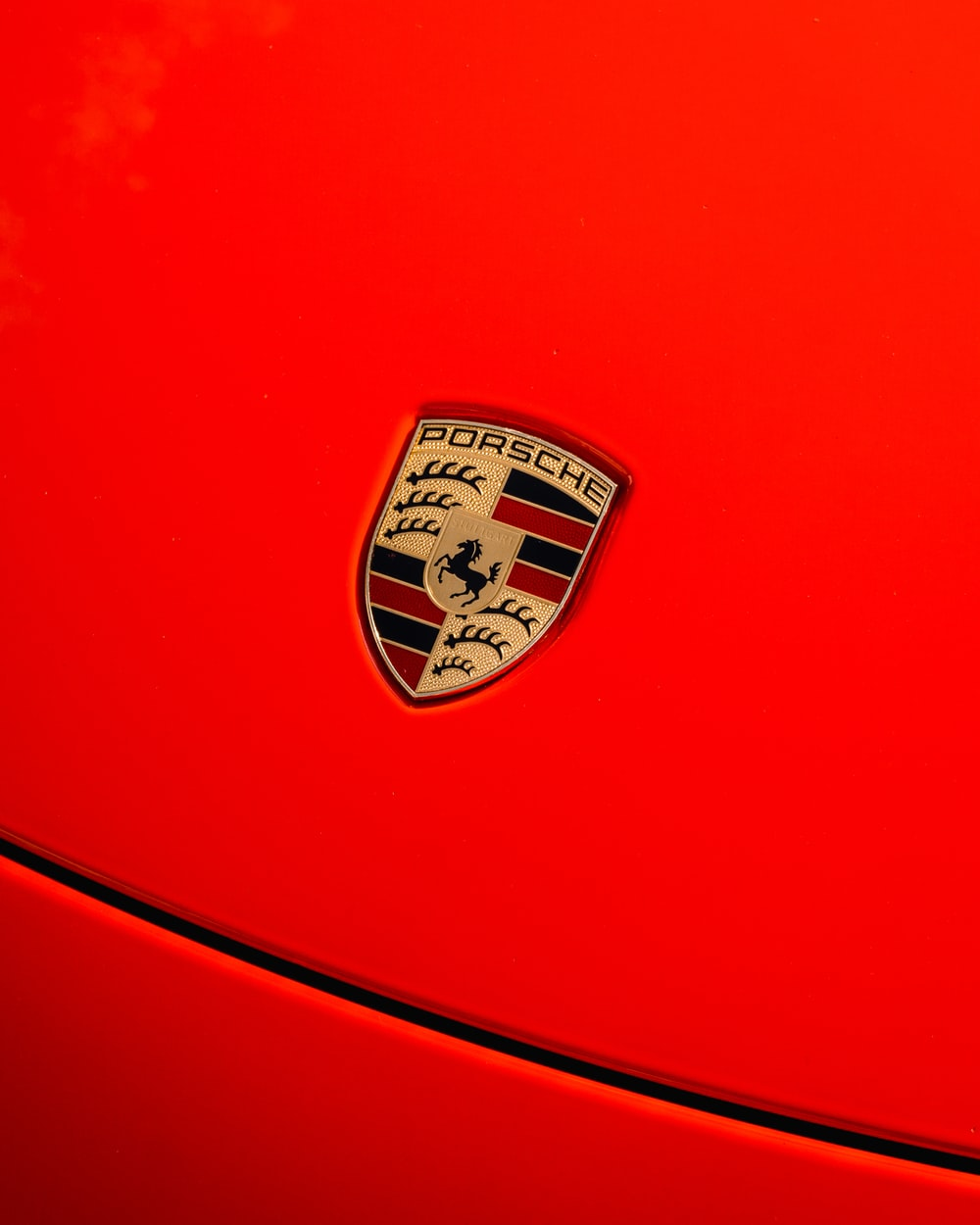 red and white car logo