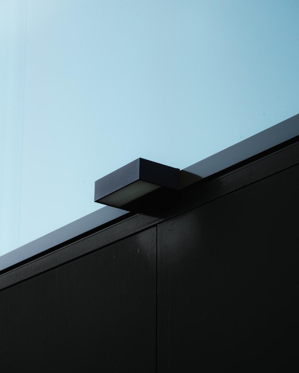 black wooden wall under blue sky