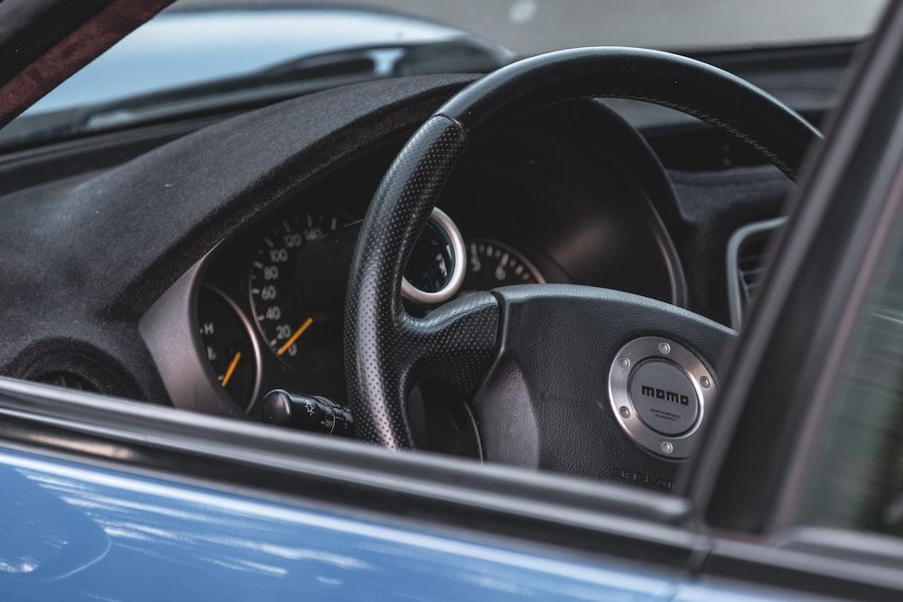 black and silver car steering wheel