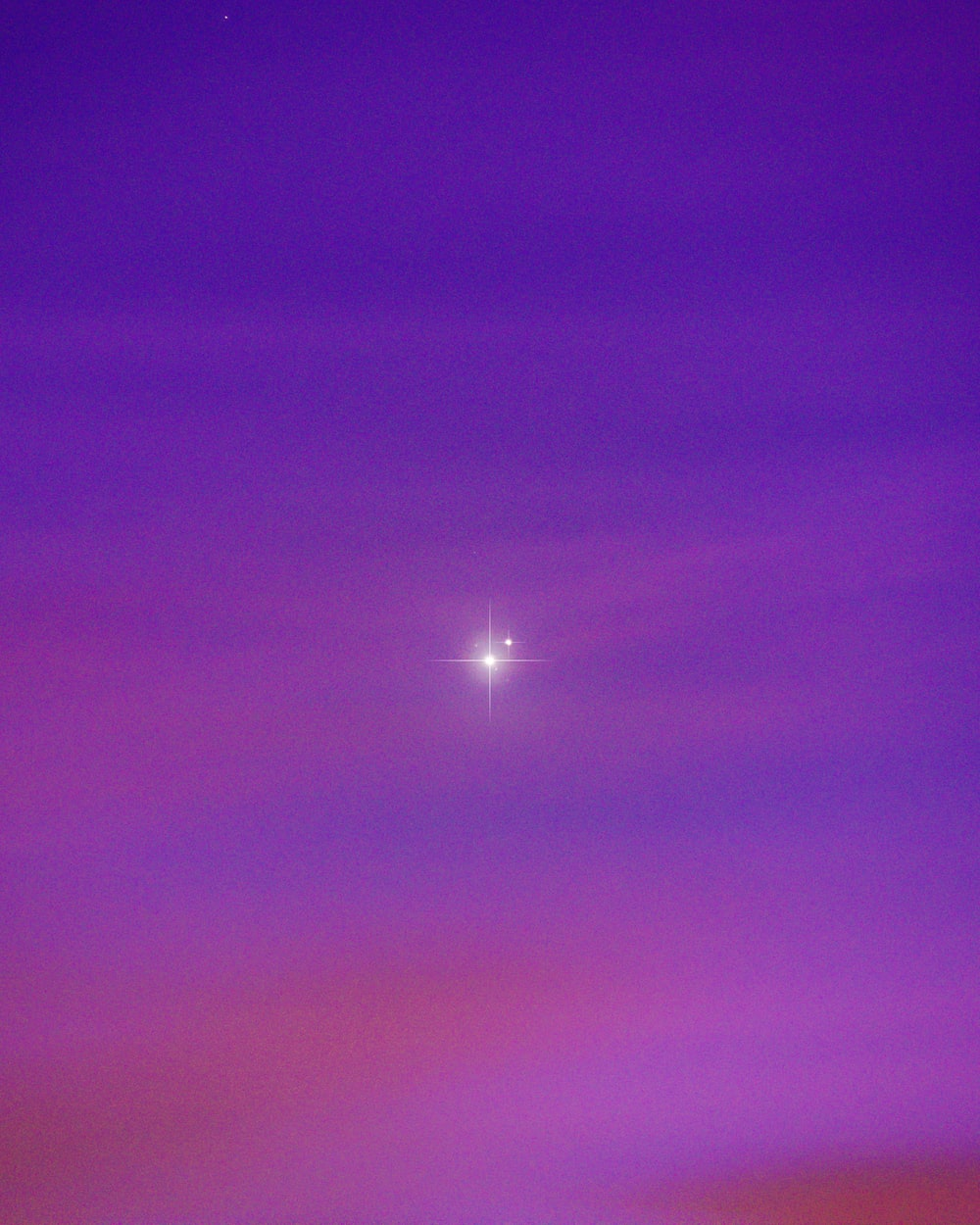 purple and blue sky with stars