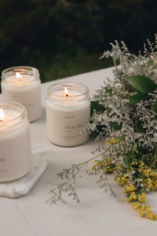 white candle on white textile
