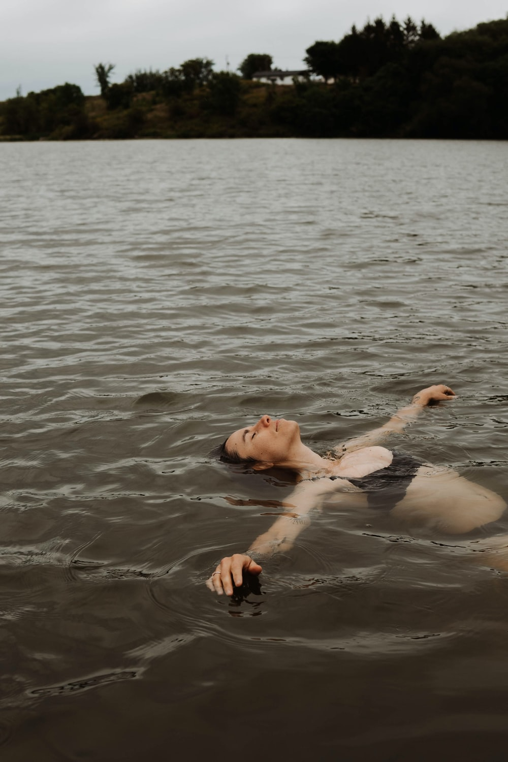 man and woman in water during daytime