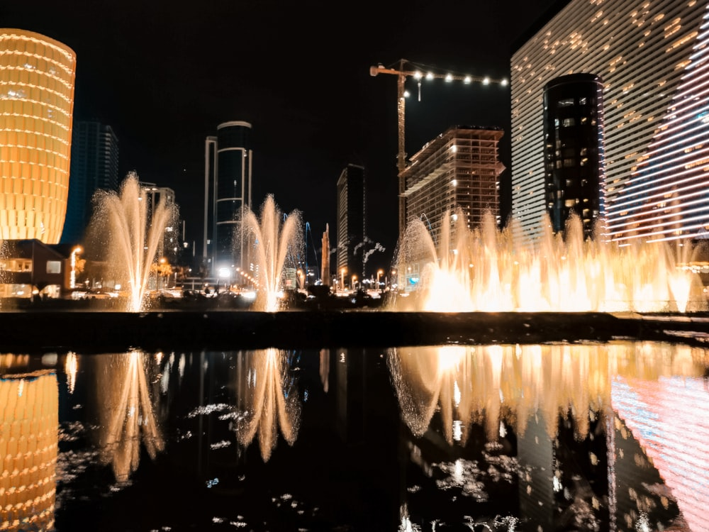 water fountain in the city during night time
