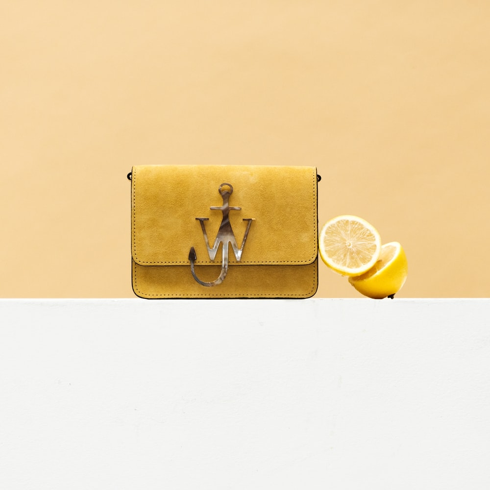 gold leather long wallet with yellow lemon and yellow round fruit