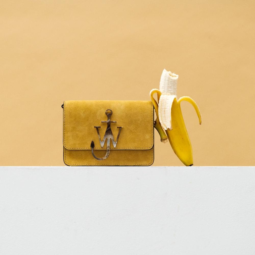 yellow banana fruit on brown paper bag