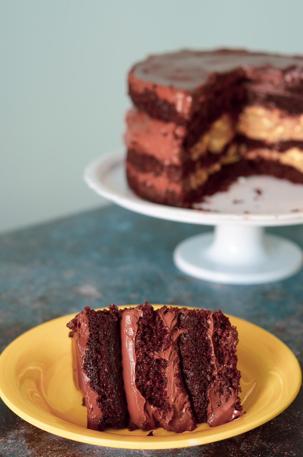 brown and white cake on yellow plate