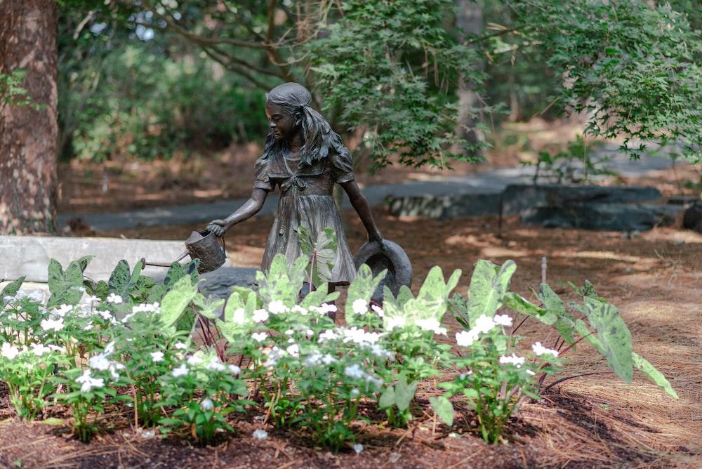 woman in black dress statue