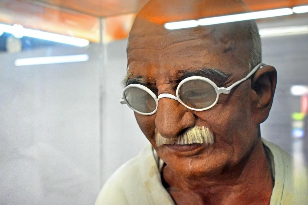 man in white collared shirt wearing eyeglasses