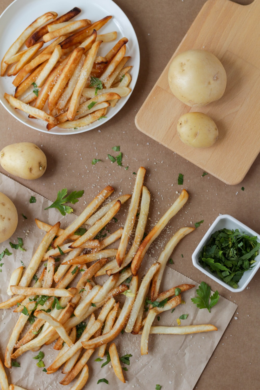potato fries and sliced of vegetables on white ceramic plate
