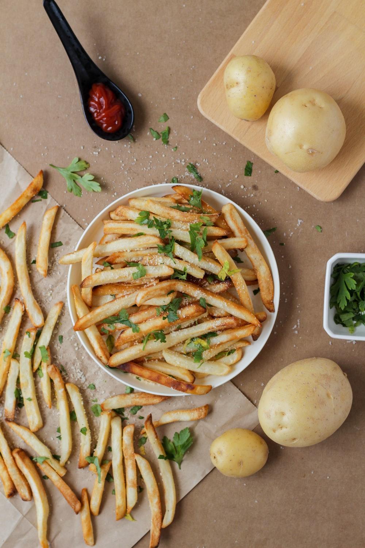 potato fries and sliced potato on white ceramic plate