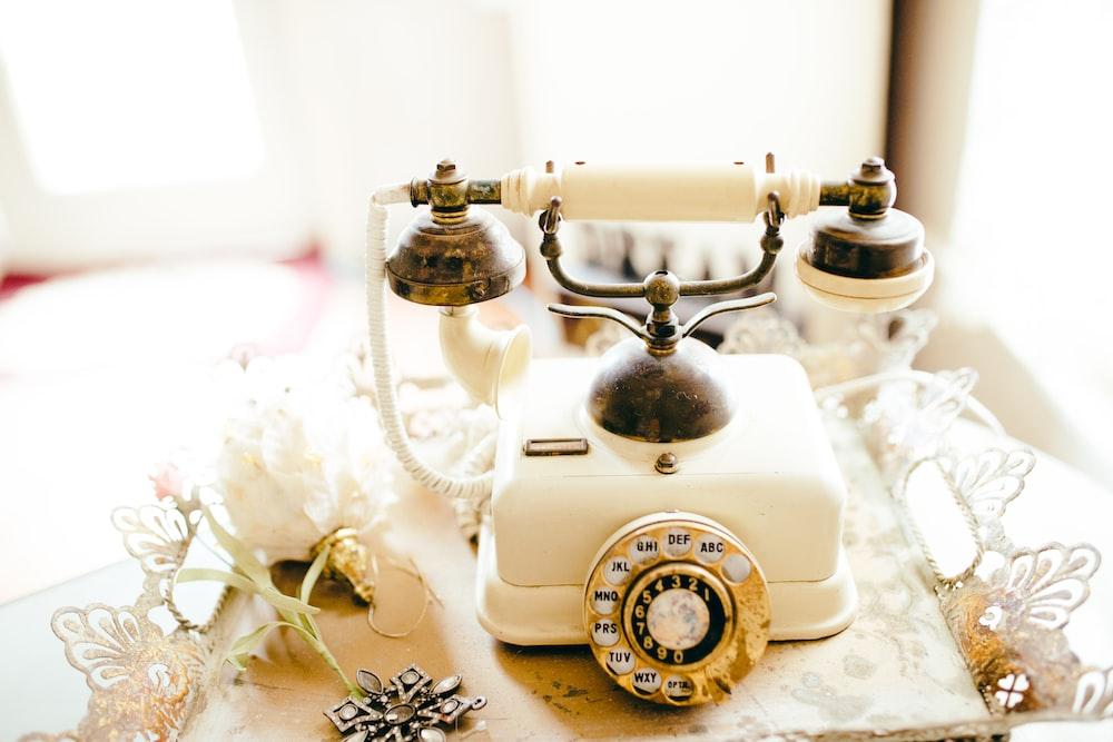 white and black rotary phone