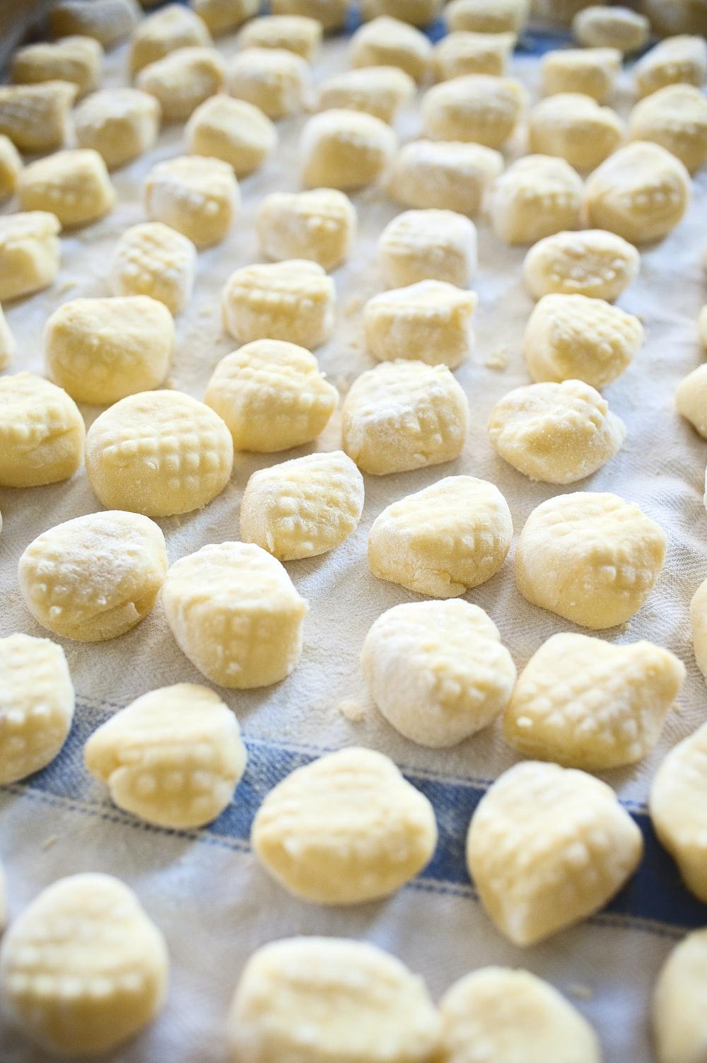 white round food on blue textile