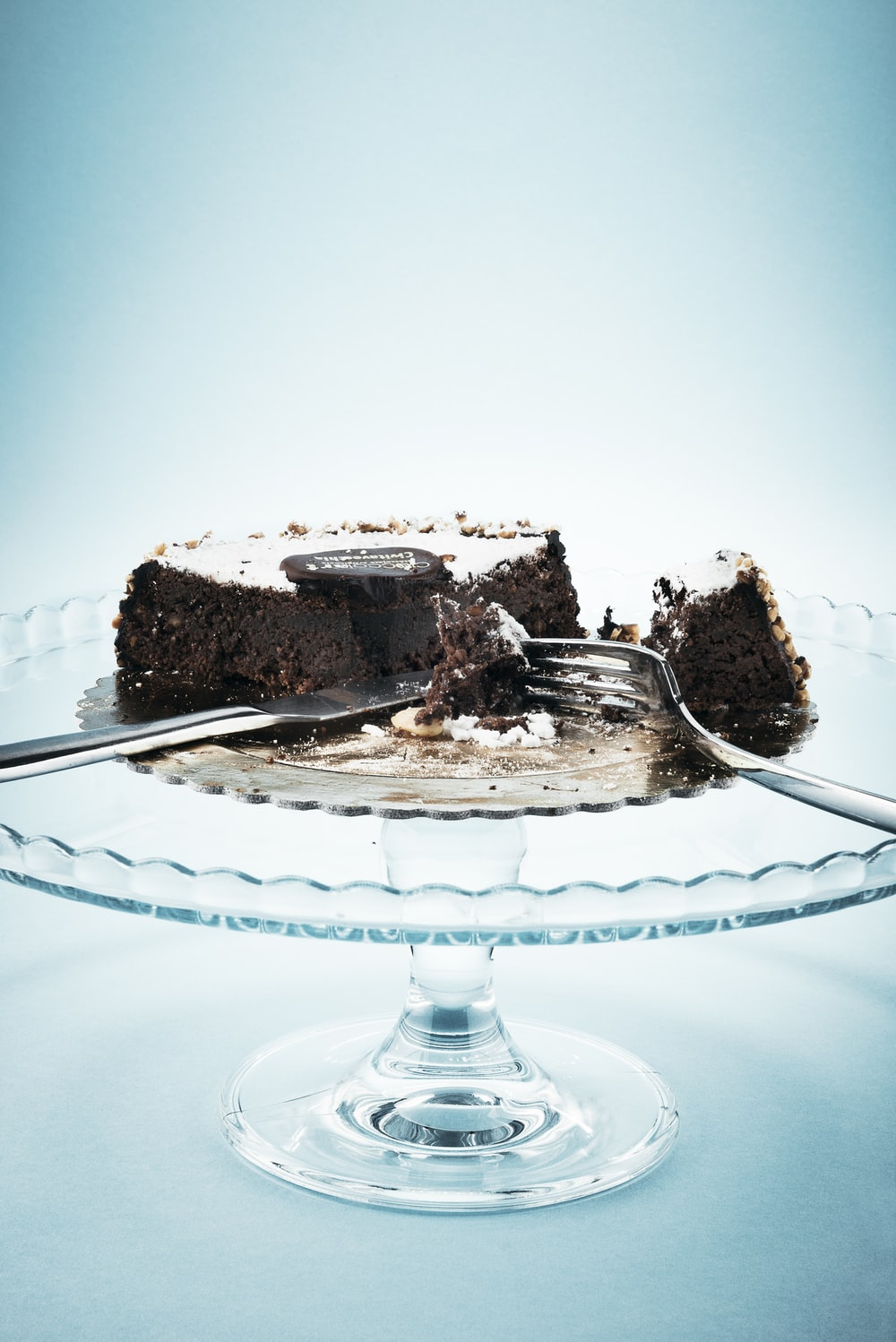 chocolate cake on clear glass cake stand