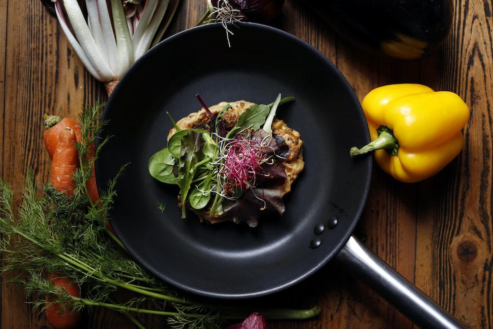 vegetable salad on black plate