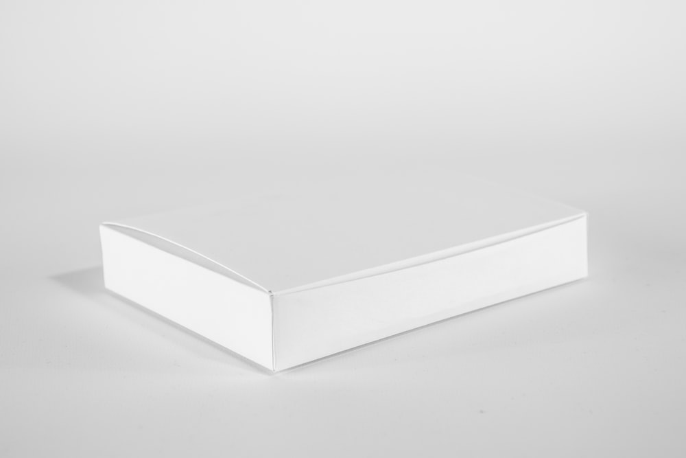 white wooden table on white surface